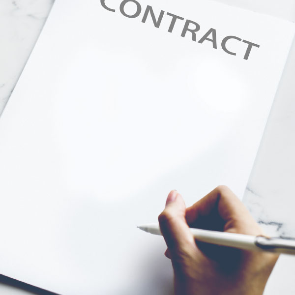 Photo of person signing a contract